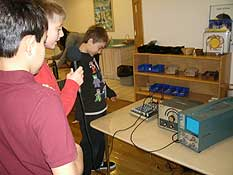 Students measure sound waves with scientific equipment
